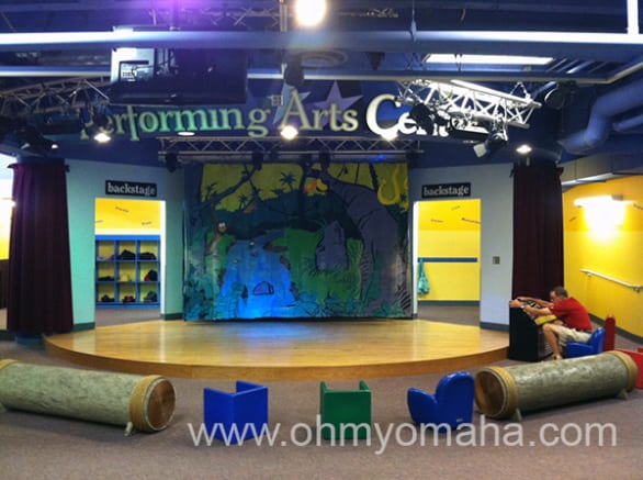 There's a stage in the basement of the children's museum, complete with a sound booth for kids to play with (or dads, as the case is here).