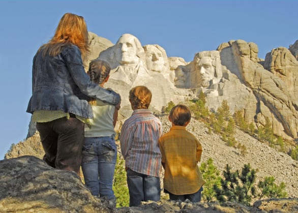 Yeah, that's totally me and the kids at Mount Rushmore. My son saw an advertisement for South Dakota and it showed a family eating ice cream cones in front of the monument, and so that's what he's dead-set on us doing. Photo by South Dakota Tourism