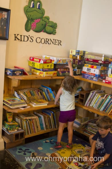 The library has several games and books for different ages, tables and some comfy couches.