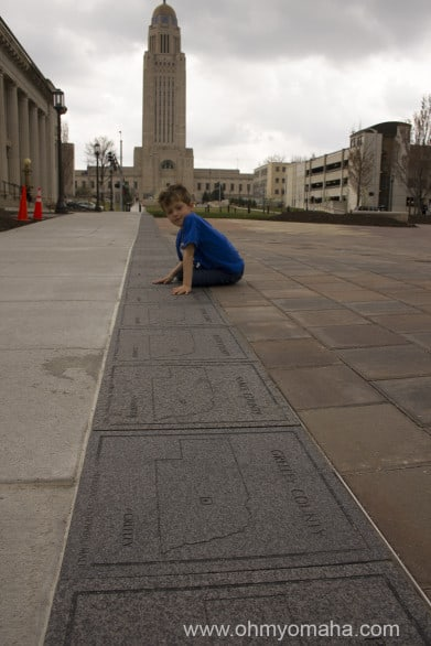 Farley tried to find our county among the tiles lining one block of the mall.