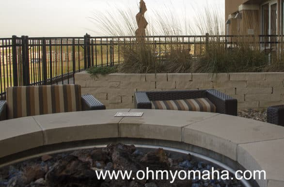 After a long day of exploring Kansas City, who wouldn't want to settle into a big chair by the fire pit with a drink?