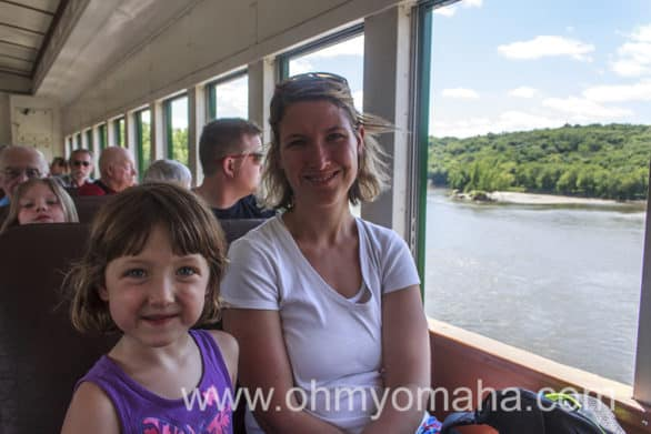 Seat buddies in coach (open windows) on the Boone & Scenic Valley Railroad.