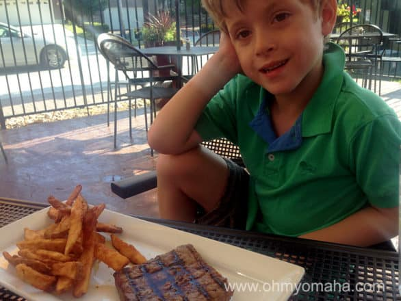 Farley contemplating the steak. Should he have ordered the cheeseburger? Deep thoughts by a 6-year-old.