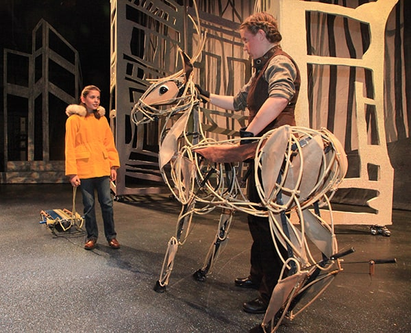 """Chloe Irwin and puppeteer Shannon Wade in """"Prancer,"""" on stage at The Rose through Dec. 23. Photo courtesy MJB Photography"""